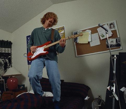 Alexi Lalas Playing His Guitar